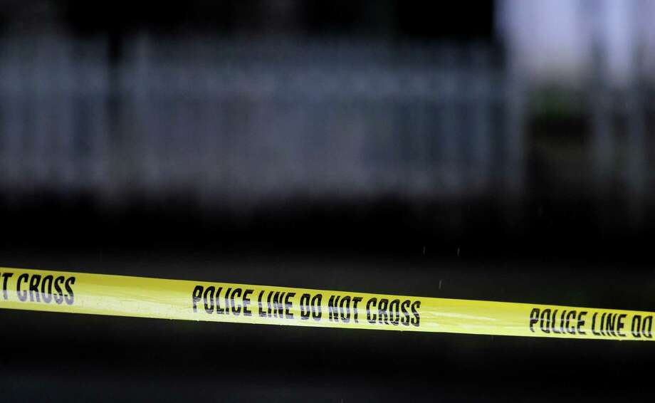 Police tape crosses the road on Bassett St. in New Haven where New Haven Police investigate a shooting on 6/25/2012. Photo by Arnold Gold/New Haven Register Photo: /