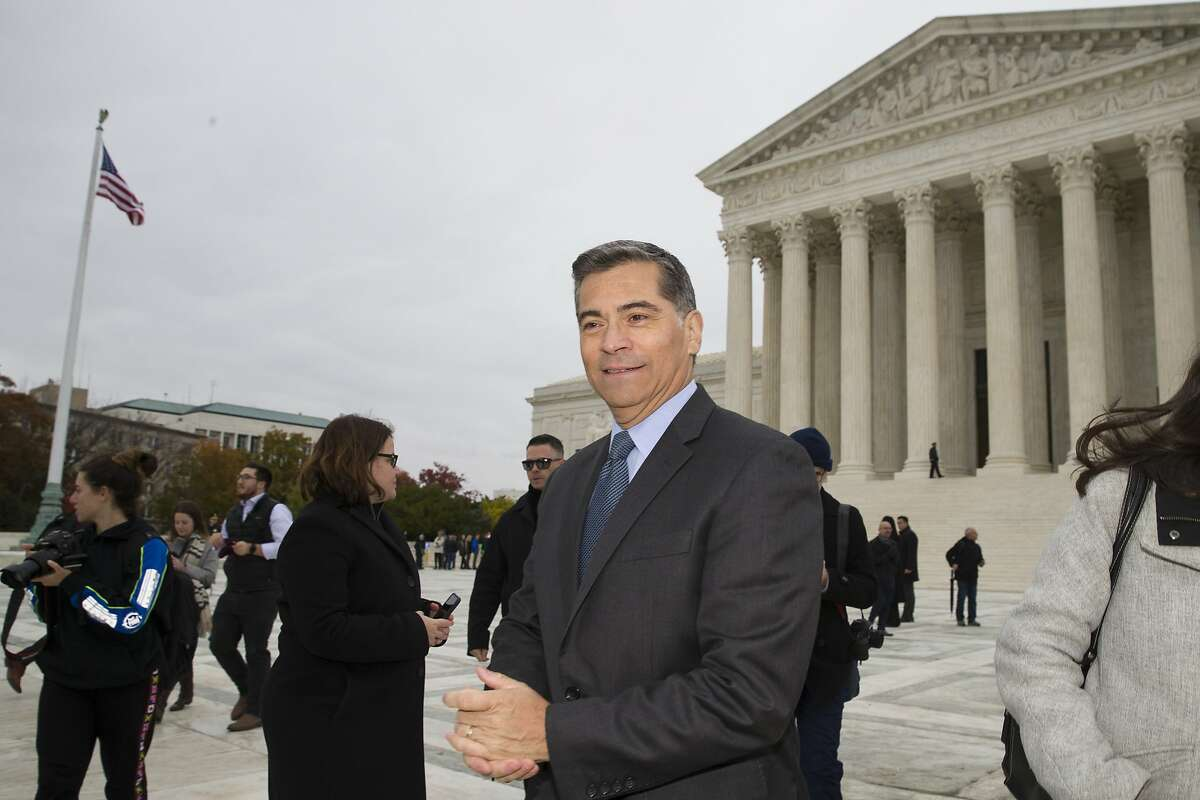 California Attorney General Xavier Becerra departs after leaving the Supreme Court after oral arguments were heard in the case of President Trump's decision to end the Obama-era, Deferred Action for Childhood Arrivals program (DACA), Tuesday, Nov. 12, 2019, at the Supreme Court in Washington. (AP Photo/Alex Brandon)