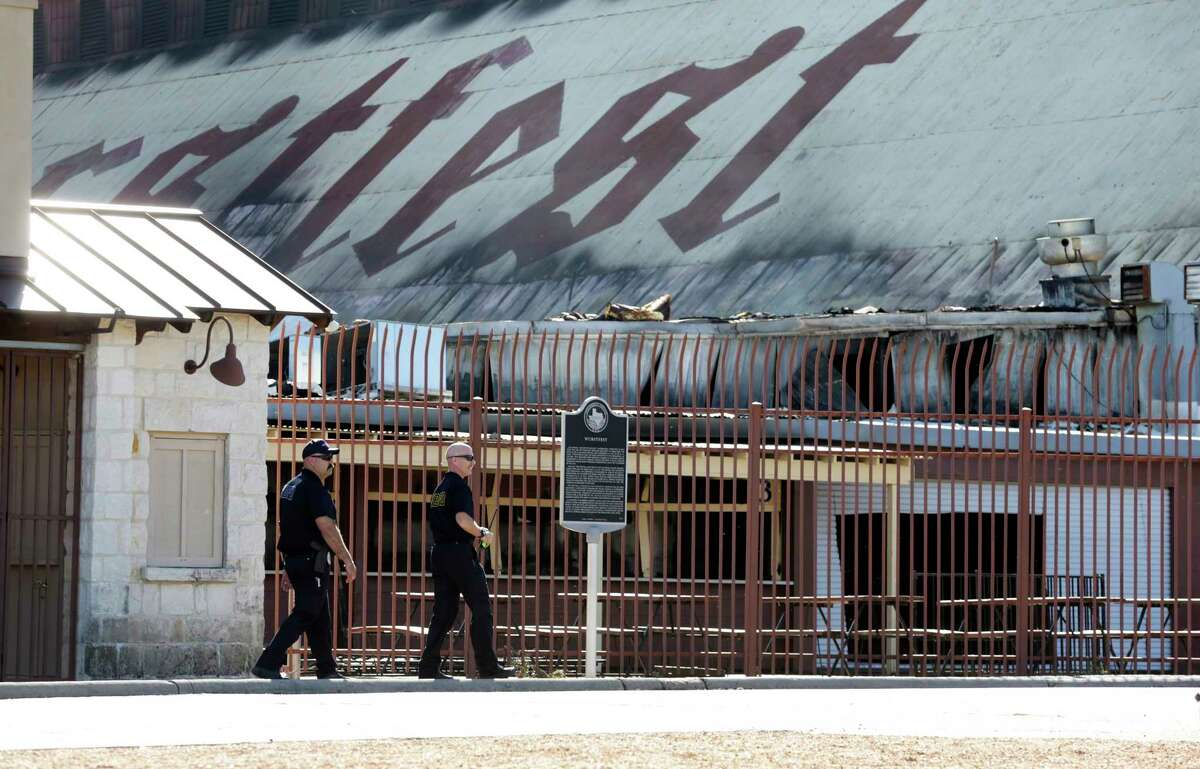 Officials look over the scene of a fire which destroyed much of the Wurstfest facility on Nov. 15, 2019.