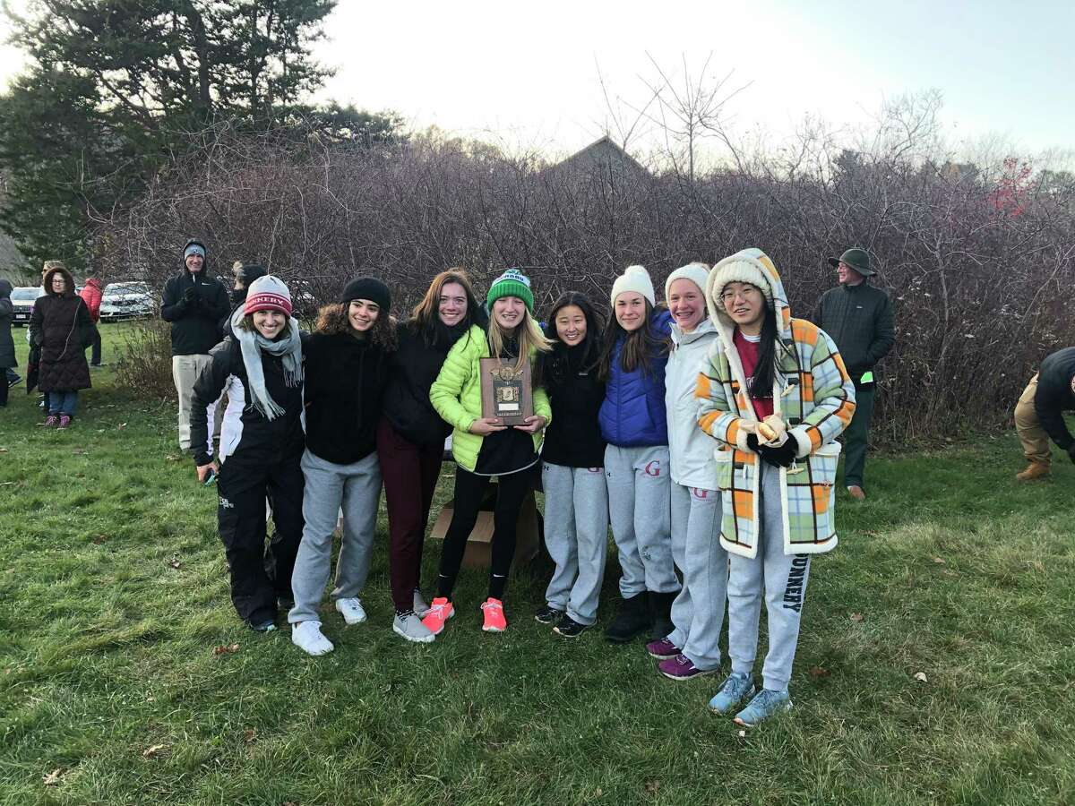 Head Coach and Morris native Morgen Fisher with the undefeated Gunnery Girls Varsity Cross Country Team, left to right, MacKenzie Teper of Brooklyn, NY, Ellie McManus of New Canaan, Gianna Russillo of Salisbury (holding the trophy), Eujin Shin of Rochester Hills, Michigan, Ksenia Korobov of Woodbury, Vivian Boucher of Watertown, Connecticut, and Yolanda Wang of Tenafly, New Jersey, after they won first place in the NEPSTA DIII Cross Country Championships at White Memorial Conservation Center in Litchfield on Nov. 9.