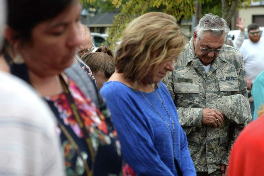 Community members and veterans observe a prayer during the annual Veterans Day program held Monday in Nederland's Veterans Park. Photo: Kim Brent / The Enterprise / BEN