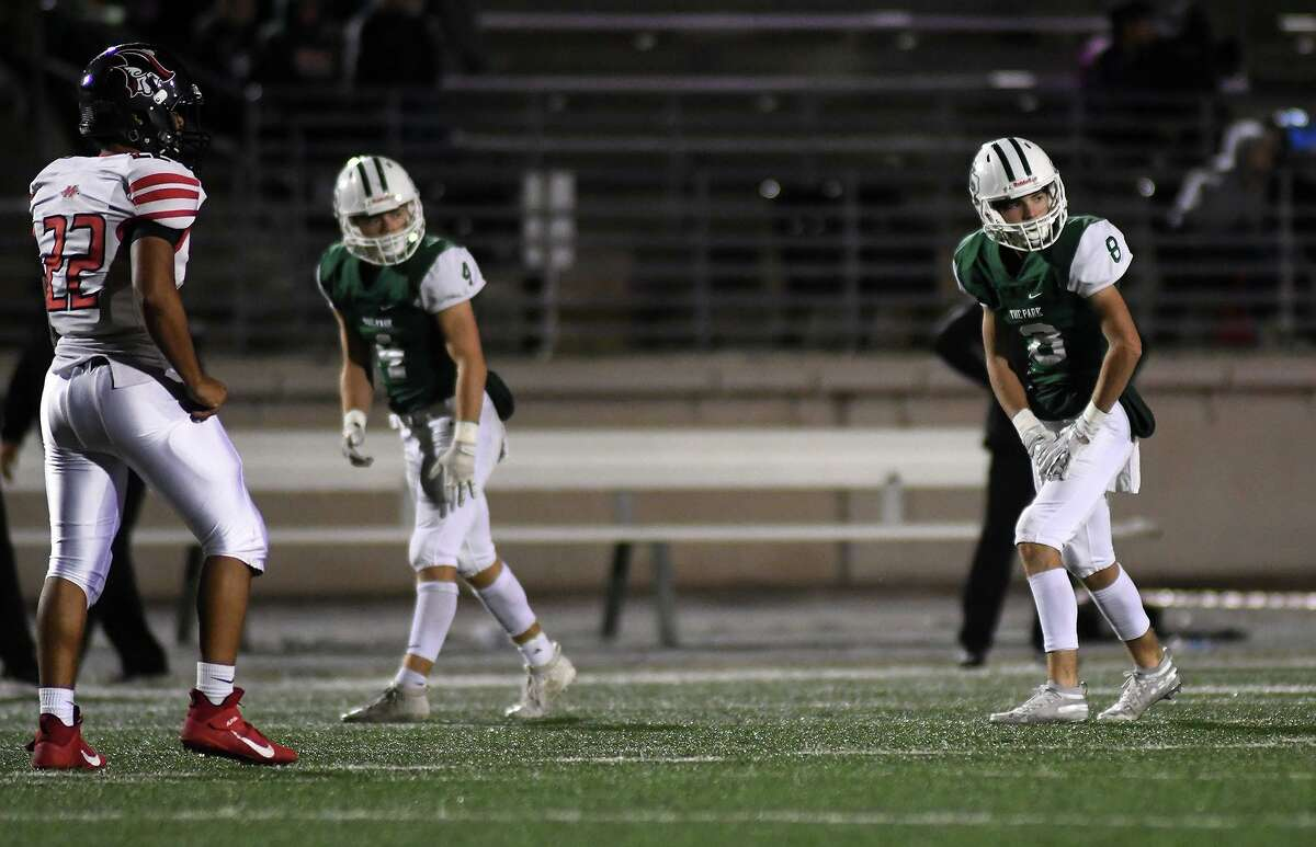 Kingwood Park senior wide receiver Canen Adrian (4) and his brother, sophomore wide receiver Graycen Adrian (8), line up against Goose Creek Memorial defender Dezmond Johnson (22) in the first quarter of their District 9-5A matchup at Turner Stadium in Humble on Nov. 7, 2019.