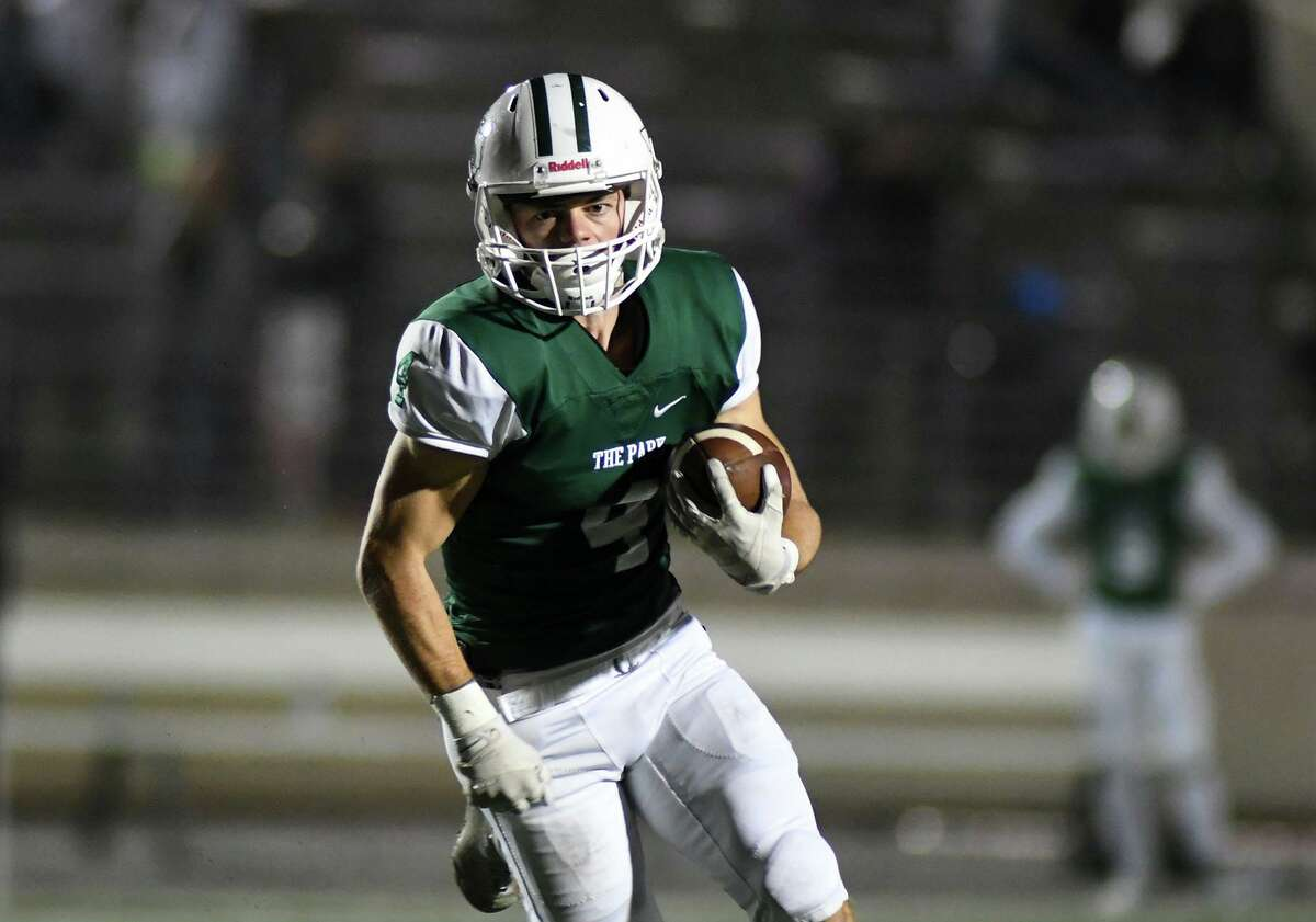 Kingwood Park senior wide receiver Canen Adrian (4) runs for yardage after a catch against Goose Creek Memorial in the first quarter of their District 9-5A matchup at Turner Stadium in Humble on Nov. 7, 2019.
