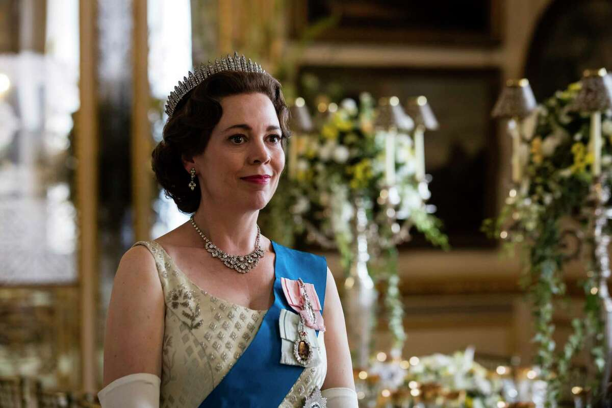 In this image released by Netflix, Olivia Colman portrays Queen Elizabeth II in a scene from the third season of