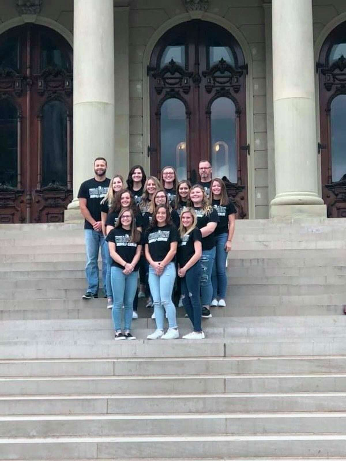 The USA Girls varsity softball state champions gather on the steps of Michigan State Capital. (Courtesy Photo)