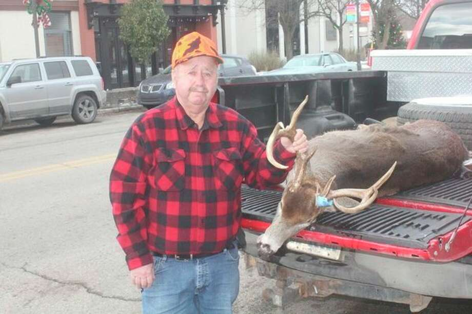 Bob Parker was the first entry in the Pioneer's Big Buck Contest on Friday. He shot an 8-point buck with 16-inch rack span. (Pioneer photo/John Raffel)