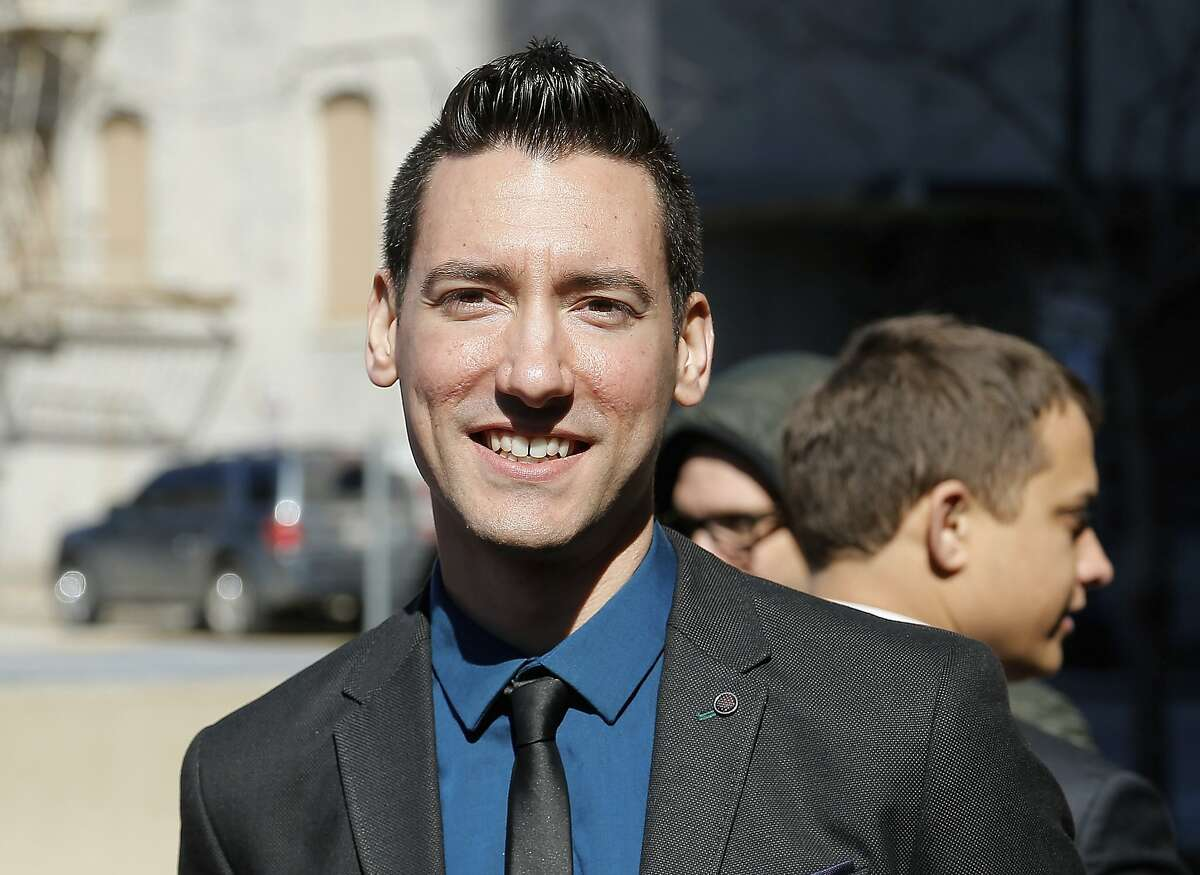 FILE - In this Feb. 4, 2016, file photo, David Daleiden, one of two indicted anti-abortion activists, speaks with supporters outside the Harris County Criminal Courthouse in Houston. A federal jury on Friday, Nov. 15, 2019, has found that Daleiden, an anti-abortion activist, illegally secretly recorded workers at Planned Parenthood clinics and is liable for violating federal and state laws. The jury ordered him and others to pay nearly $1 million in damages. (AP Photo/Bob Levey, File)