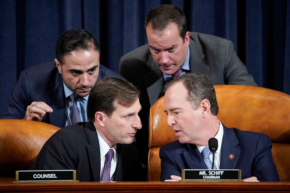 House Intelligence Committee Chairman Adam Schiff (R) (D-CA) speaks with Democratic Counsel Daniel Goldman (L) and other staffers during testimony from Marie Yovanovitch, former US ambassador to Ukraine, during a House Intelligence Committee hearing as part of the impeachment inquiry into US President Donald Trump on Capitol Hill in Washington, DC on November 15, 2019. (Photo by JOSHUA ROBERTS / POOL / AFP) (Photo by JOSHUA ROBERTS/POOL/AFP via Getty Images)