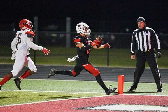 Hargrave's Peyton Pierson (6) scores the first of his three touchdowns in the Falcons' 49-6 victory over the Furr Brahmans in the Bi-District round of the playoffs on Nov. 14 at Falcon Stadium in Huffman