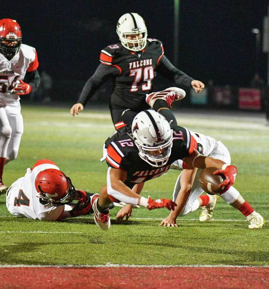 Hargrave's A.J. San Miguel (12) had three rushing touchdowns in the Falcons' 49-6 victory over the Furr Brahmans in the Bi-District round of the playoffs on Nov. 14 at Falcon Stadium in Huffman Photo: Greg Valk, 59N Sports