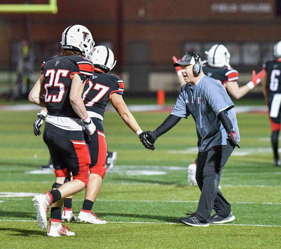 Hargrave coach Mike McEachern congratulates Jacob Watson (17) and Chase Padgett (25) after the defense forced a three-and-out in the Falcons' 49-6 victory over the Furr Brahmans in the Bi-District round of the playoffs on Nov. 14 at Falcon Stadium in Huffman Photo: Greg Valk, 59N Sports