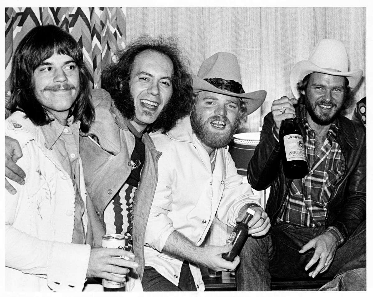 11/27/1975 - Z.Z.Top Rock Music Group, left to right: Frank Beard, TV show host Crash (KLOL radio DJ Crash Collins ), Dusty Hill and Billy Gibbons at a party on the 19th floor of Stouffer's following the Nov. 27, 1975 concert at the Summit. HOUCHRON CAPTION (11/21/2003): Beard, TV host Crash, Hill and Gibbons celebrate on the 19th floor of Stouffer's Hotel following ZZ Top's first concert at the Summit on Nov. 27, 1975.