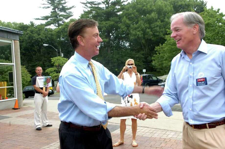 Ned Lamont, left, Democratic candidate for governor, shakes hands with Tom Foley, Republican candidate for governor, at Greenwich High School, on Tuesday, Aug. 10, 2010. Photo: Helen Neafsey / Greenwich Time