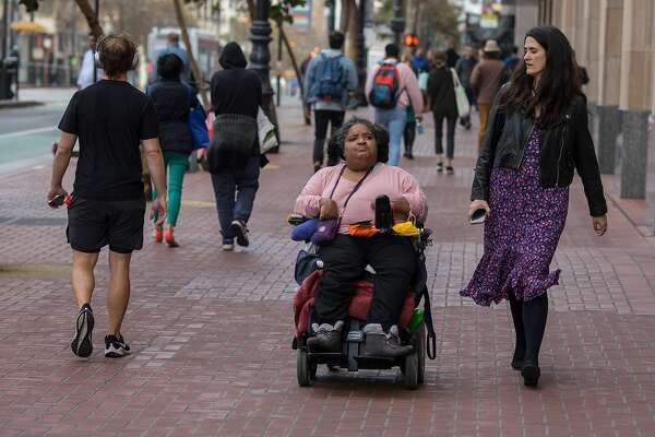 Micaela Connery, right, walks with Elizabeth Grigsby down Grove Street in San Francisco on Wednesday, Nov. 13 , 2019. Connery is the Founder and CEO of The Kelsey, a group that develops housing for adults with disabilities. Grigsby is a board member and advisor to The Kelsey. The Kelsey has a new development that will be near the corner of Grove and Van Ness.