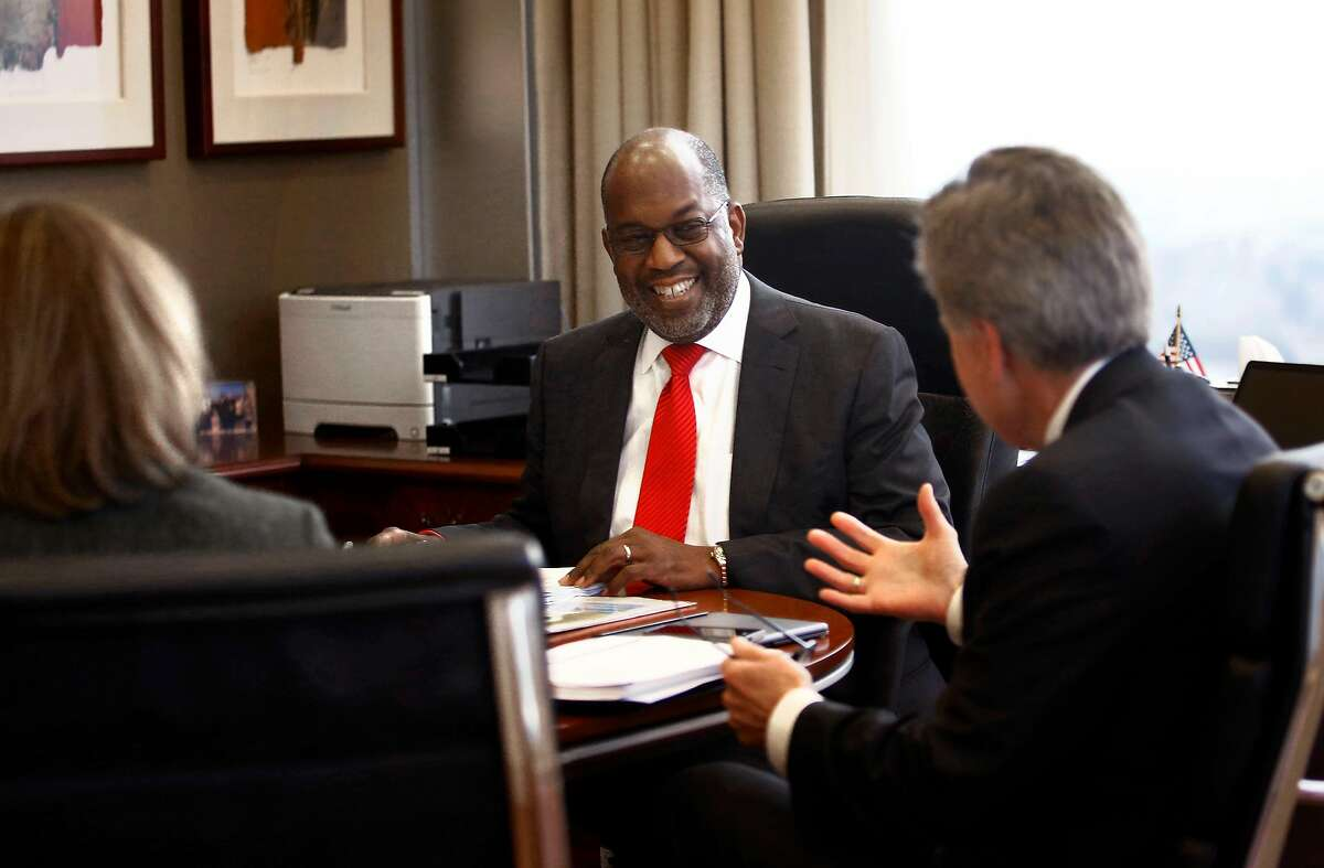 CEO Bernard Tyson (middle) of Kaiser Permanente starts a meeting at his office in Oakland, Calif., on Monday, January 26, 2015.