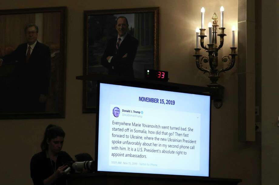 A tweet from President Donald Trump is displayed on a monitor as former U.S. Ambassador to Ukraine Marie Yovanovitch testifies before the House Intelligence Committee on Capitol Hill in Washington, Friday, Nov. 15, 2019, during the second public impeachment hearing of President Donald Trump's efforts to tie U.S. aid for Ukraine to investigations of his political opponents. (AP Photo/Andrew Harnik) Photo: Andrew Harnik, STF / Associated Press / Copyright 2019 The Associated Press. All rights reserved