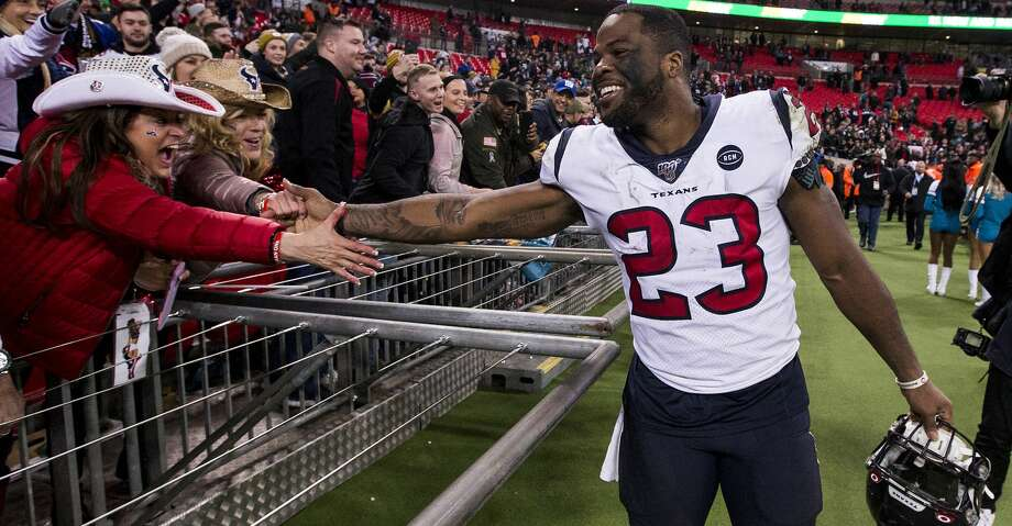 Houston Texans running back Carlos Hyde (23) celebrates the Texans 26-3 win over the Jacksonville Jaguars with fans following an NFL football game at Wembley Stadium on Sunday, Nov. 3, 2019, in London. Photo: Brett Coomer/Staff Photographer