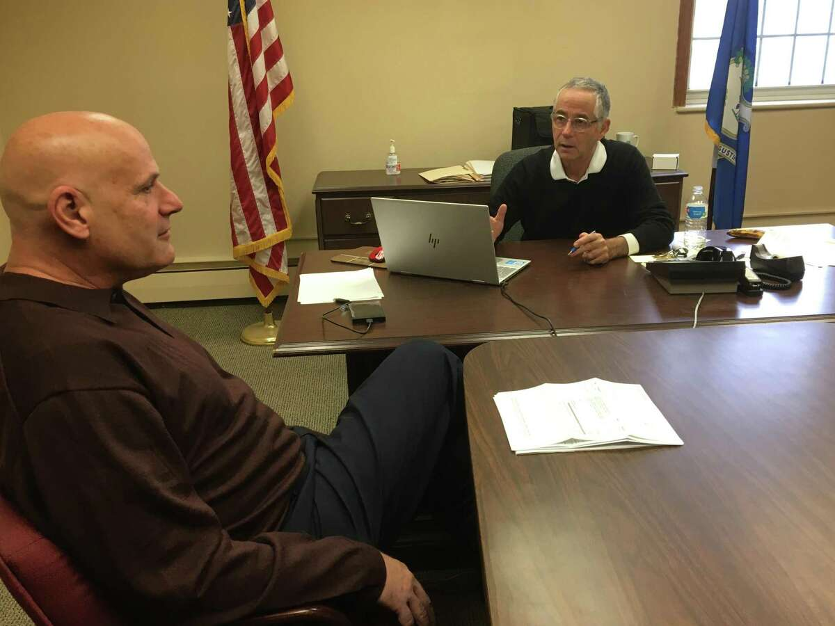 Ougoing East Haven Mayor Joe Maturo Jr., right, meets with Mayor-elect Joe Carfora, left, in his office on Wednesday, Nov. 13, 2019.