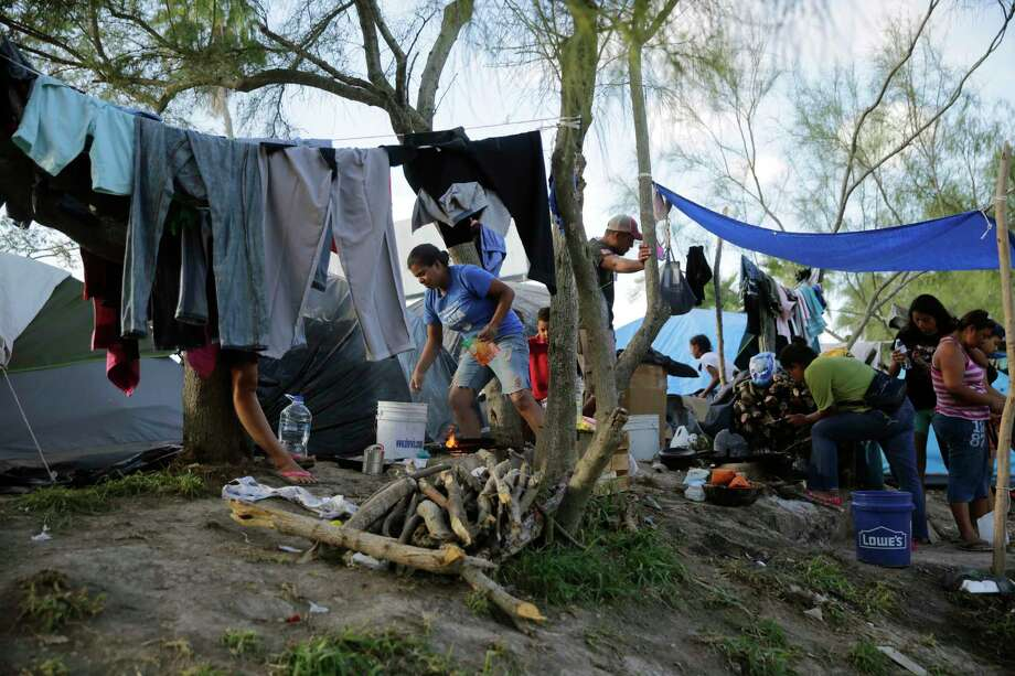 "Migrants wait in a refugee camp in Matamoros, Mexico, this month. The camp is an outgrowth of the Trump administration's ""Remain in Mexico"" immigration policy, which sends those most in need of protection to the dangerous streets of Matamoros. Photo: Eric Gay / Associated Press / Copyright 2019 The Associated Press. All rights reserved."