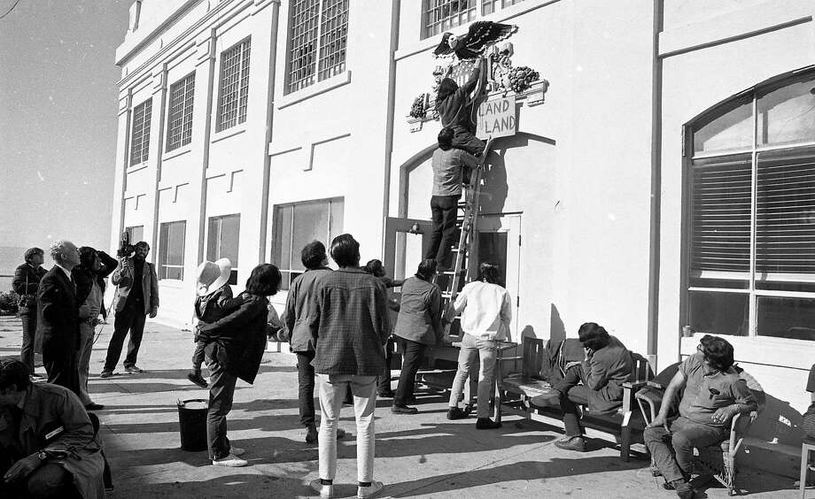 """Photo of the Native American occupation of Alcatraz from 1969 to 1971. A sign created by the activists says """"This Land is My Land."""" Photo: Vincent Maggiora / The Chronicle"""