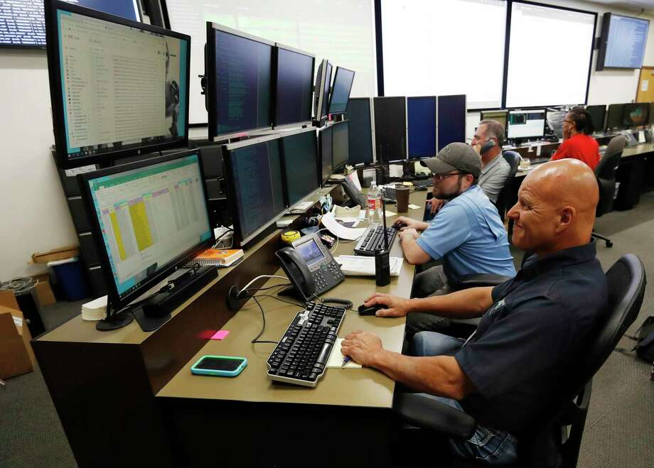 """In this Sept. 12, 2019, photo, monitors check their screens in the Governor's Office of Information Technology in Denver. Some cybersecurity professionals are concerned that insurance policies designed to limit the damage of ransomware attacks might actually be encouraging hackers. """"We don't know what that ransom payment is going to fund,"""" said Brandi Simmons, a spokeswoman for the office. """"As a state government, we don't want to be in a position of funding cyberterrorists."""" (AP Photo/David Zalubowski) Photo: David Zalubowski, STF / Associated Press / Copyright 2019 The Associated Press. All rights reserved."""
