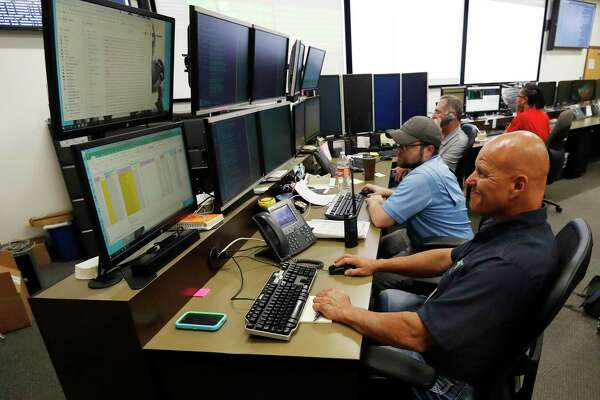 """In this Sept. 12, 2019, photo, monitors check their screens in the Governor's Office of Information Technology in Denver. Some cybersecurity professionals are concerned that insurance policies designed to limit the damage of ransomware attacks might actually be encouraging hackers. """"We don't know what that ransom payment is going to fund,"""" said Brandi Simmons, a spokeswoman for the office. """"As a state government, we don't want to be in a position of funding cyberterrorists."""" (AP Photo/David Zalubowski)"""