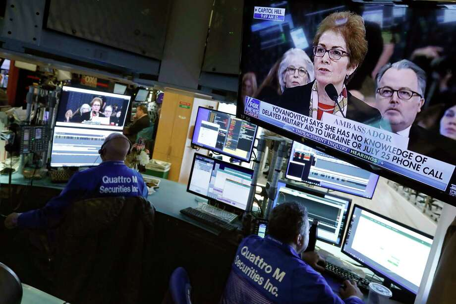 Former U.S. Ukraine Ambassador Marie Yovanovitch appears on televisions on the floor of the New York Stock Exchange, Friday, Nov. 15, 2019. Stocks are opening broadly higher on Wall Street as hopes continued to grow that the U.S. and China were moving closer to a deal on trade. (AP Photo/Richard Drew) Photo: Richard Drew / Copyright 2019 The Associated Press. All rights reserved