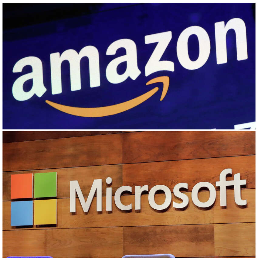 FILE - This combination of file photos shows the logos for Amazon, top, and Microsoft. Amazon is protesting the Pentagona€™s decision to award a huge cloud-computing contract to Microsoft, citing a€œunmistakable biasa€ in the decision. Amazona€™s competitive bid for the a€œwar clouda€ drew criticism from President Donald Trump and its business rivals. (AP Photo/Richard Drew and Ted S. Warren, File)