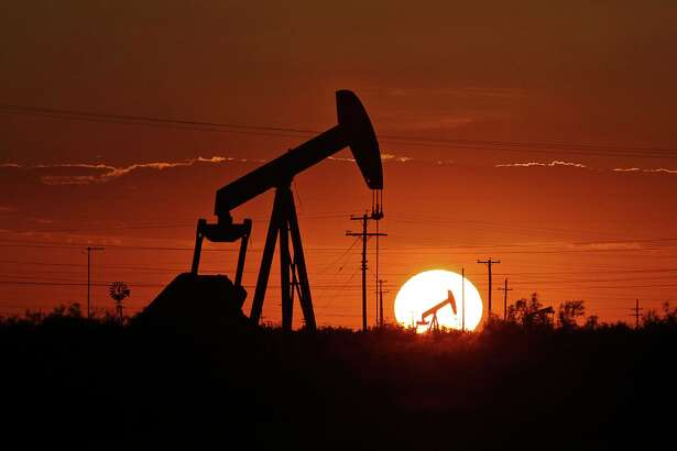 FILE - In this June 11, 2019, file photo a pump jack operates in an oil field in the Permian Basin in Texas. Drilling of the longest horizontal oil and gas well in the history of the Permian Basin has been completed as booming oil production in the region continues to center around shale in southeast New Mexico and West Texas. (Jacob Ford/Odessa American via AP, File)