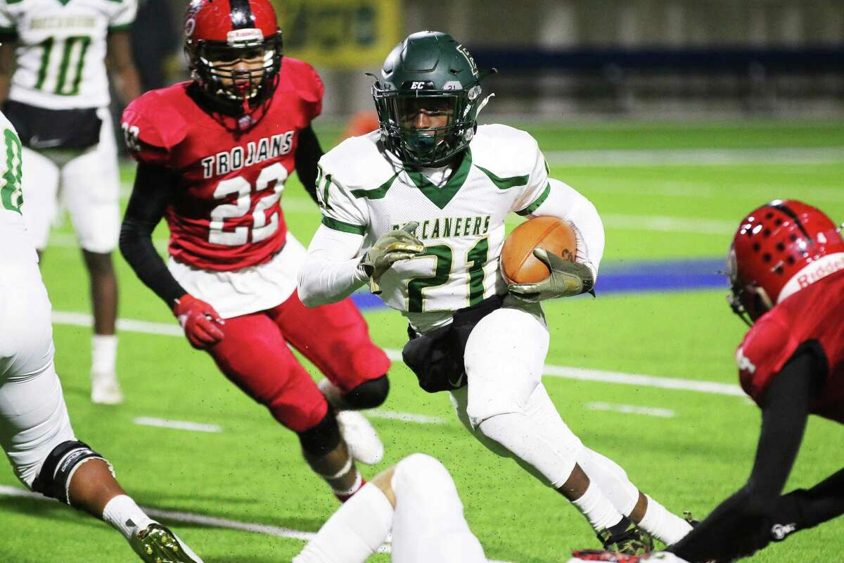 Buccaneer running back Nolton Shelvin scrambles for big yardage in the win over Coldspring-Oakhurst in the first-round playoff game Thursday night.