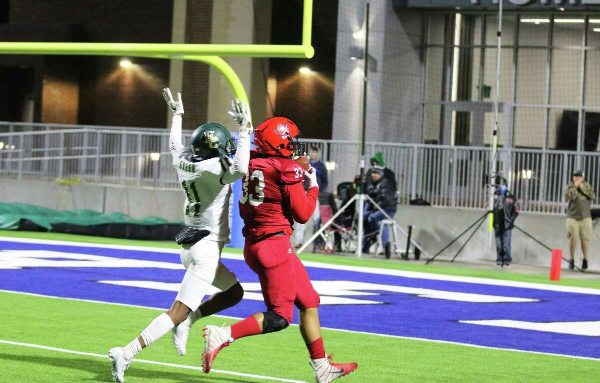 Wide receiver Dante Eldridge receives a touchdown pass over the shoulder from QB Jeromy Harden in Thursday night's first-round playoff game against East Chambers. Buccaneer defensive back Keyrin Green holds his hands up signaling he wasn't interfering with his coverage.
