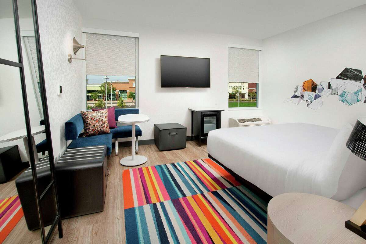 Aloft hotels have rooms featuring airy nine-foot-high ceilings, plush platform beds, WiFi, 55-inch LCD TVs, and a minimalist style. This photo is a representation of the hotel's facilities and amenities.