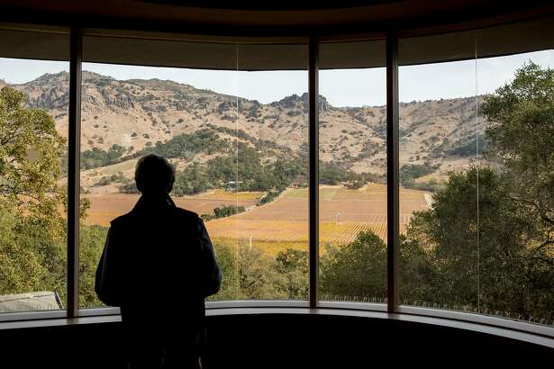 World-renowned vintner and founder of Stag Leap Cellars Warren Winiarski looks out a large window of his home and onto the vineyards of Stag Leap Cellars in Napa, Calif. Tuesday, Nov. 12, 2019.