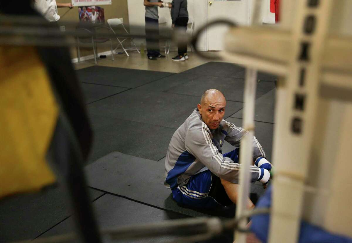 Former Boxing Champion John Michael Johnson works out at TMB Morones Boxing on Wednesday, Nov. 13, 2019 for an upcoming fight this weekend. Johnson, 51, a former three-time boxing champion will face 24-year-old Omar Castillo, Jr. of San Juan, Texas. (Kin Man Hui/San Antonio Express-News)