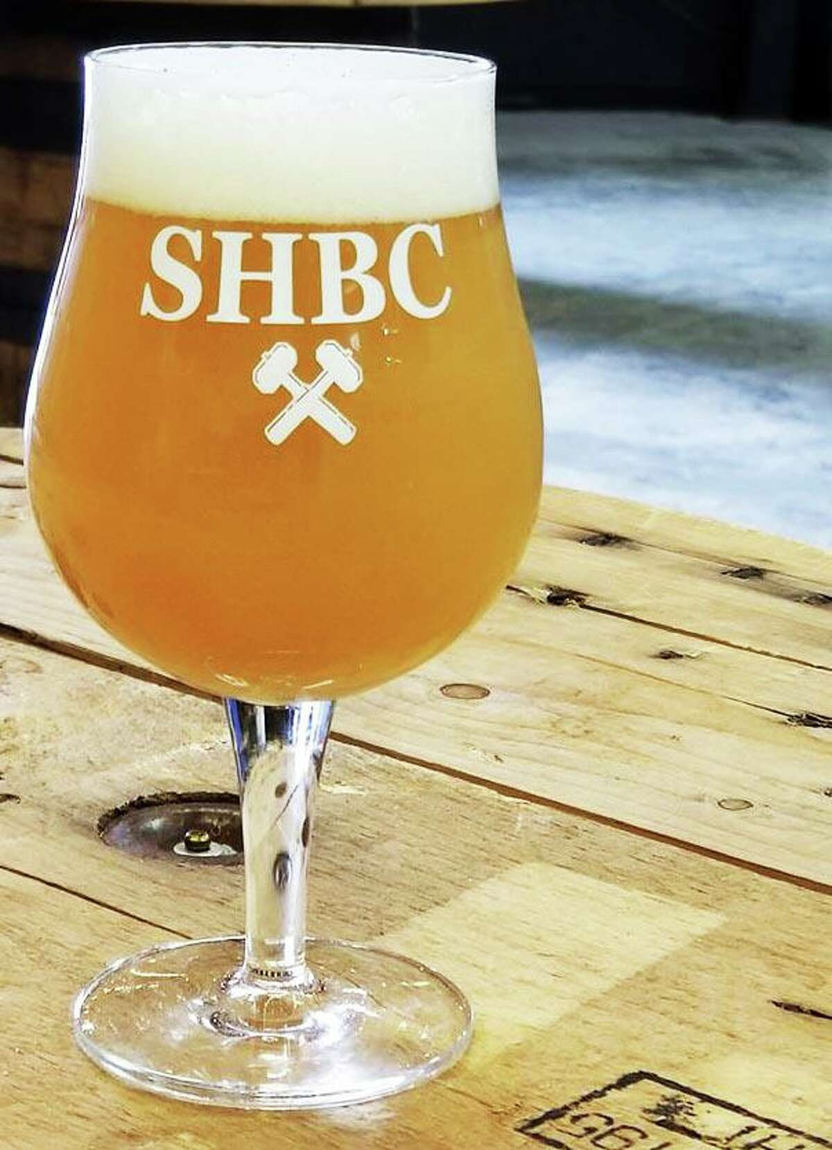 Shown is Haddam's Steady Habit Brewery Grand Prismatic 100-percent Mosiac NEIPA. It tastes of tropical fruits, with a smooth, silky mouthfeel and clean crisp finish, according to the owners.