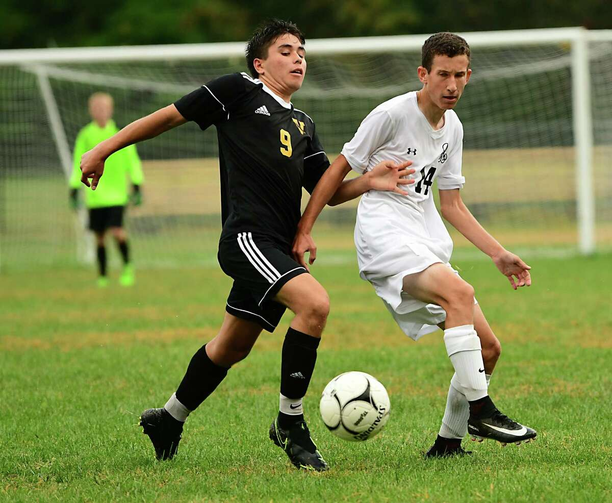 Voorheesville's Jack Ensslin, #9, battles for the ball with Albany Academy's Josh Mitchell during a soccer game on Monday, Sept. 23, 2019 in Voorheesville, N.Y. (Lori Van Buren/Times Union)