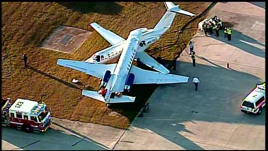 Two planes collide on runway at San Antonio airport ... on red wood airplane, coke airplane, rockstar airplane, dr pepper airplane, red aircraft, oakley airplane, lamborghini airplane,
