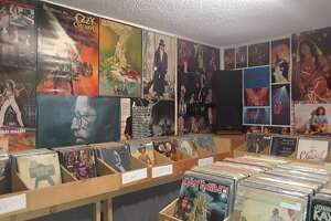 John DiBella recently opened Revolution Records on Willow Street in Torrington. The little store is decorated with posters DiBella once had on his bedroom walls as a teenager.