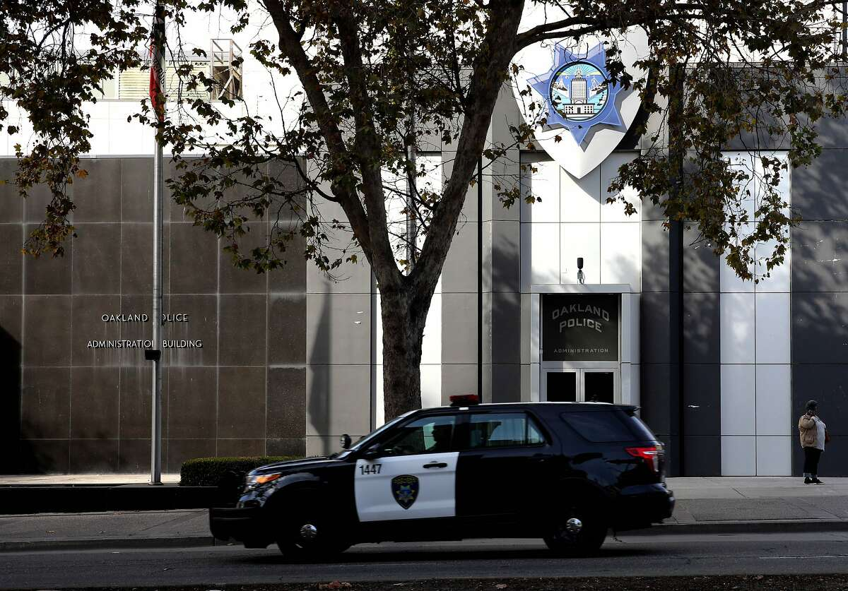 An Oakland police vehicle passes the Oakland Police Department, located at 455 7th St., in Oakland, Calif., on Wednesday, November 13, 2019.