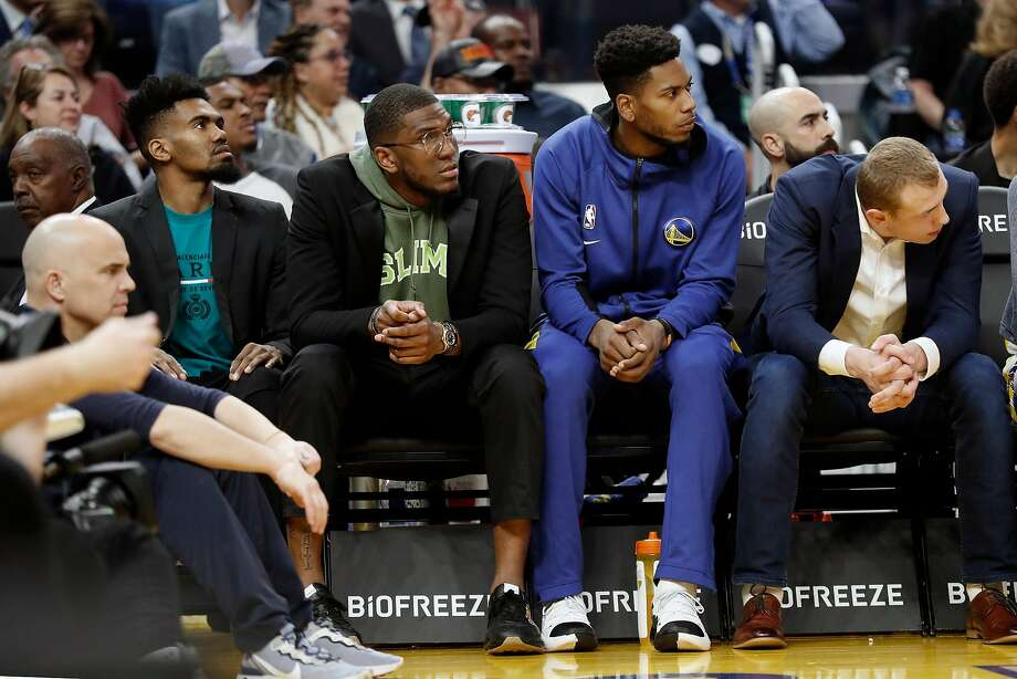 Golden State Warriors' Jacob Evans III, Kevon Looney, Glenn Robinson III  and Alan Smailigic on bench against Utah Jazz during NBA game at Chase Center in San Francisco, Calif., on Monday, November 11, 2019. Photo: Scott Strazzante / The Chronicle