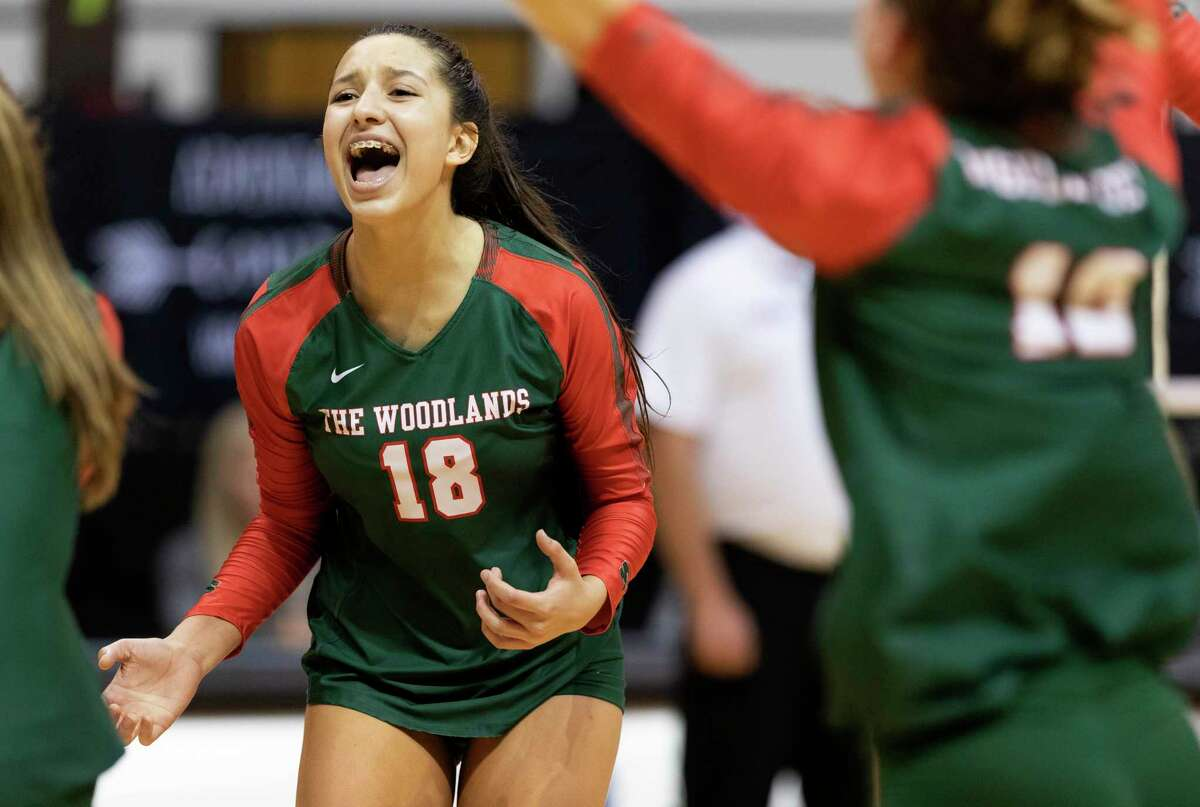 The Woodlands outside hitter Julieta Valdes (18) reacts after an ace by Dylan Maberry during the first set of a Region II-6A semifinal volleyball match at Sam Houston State University, Friday, Nov. 15, 2019, in Huntsville.