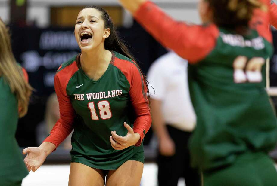 The Woodlands outside hitter Julieta Valdes (18) reacts after an ace by Dylan Maberry during the first set of a Region II-6A semifinal volleyball match at Sam Houston State University, Friday, Nov. 15, 2019, in Huntsville. Photo: Jason Fochtman, Houston Chronicle / Staff Photographer / Houston Chronicle