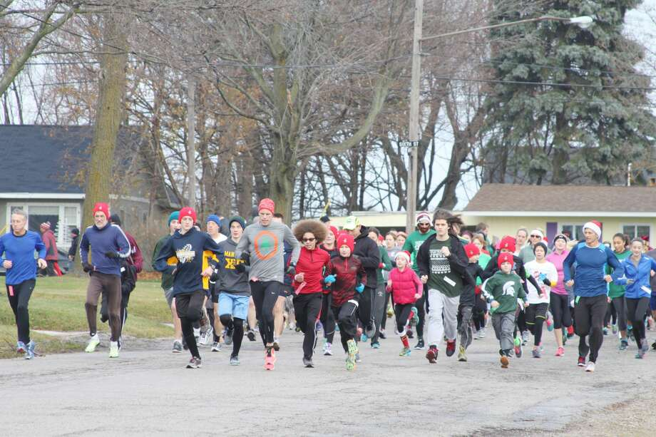 The annual Jingle Bell Jog will be held on Dec. 7, during Manistee's Old Christmas Weekend festivities. Photo: News Advocate File Photo