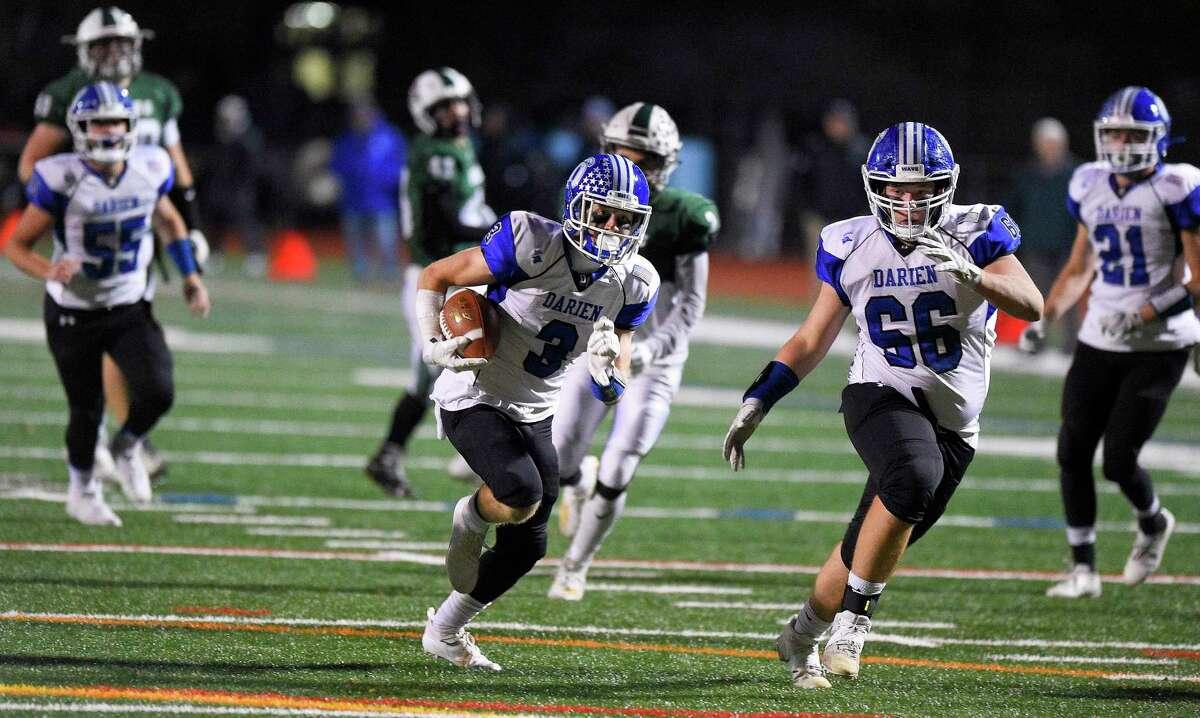 Darien's Sean Gifford (3) carries for a 30 yard touchdown from QB Peter Graham in the first quarter against Norwalk in a FCIAC football game at Norwalk High School Testa Field on Nov. 15, 2019 in Norwalk Connecticut.