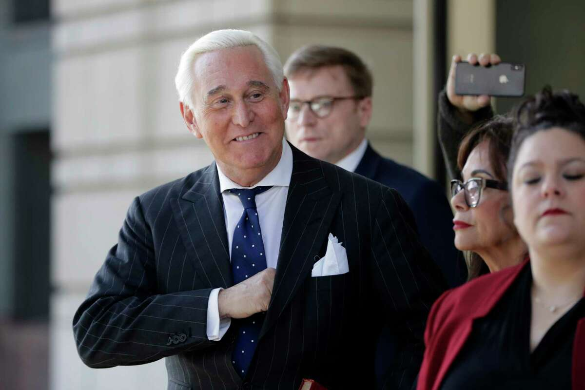 Roger Stone, left, with his wife Nydia Stone, second from right, leaves federal court in Washington, Friday, Nov. 15, 2019. Stone, a longtime friend of President Donald Trump, has been found guilty at his trial in federal court in Washington. (AP Photo/Julio Cortez)