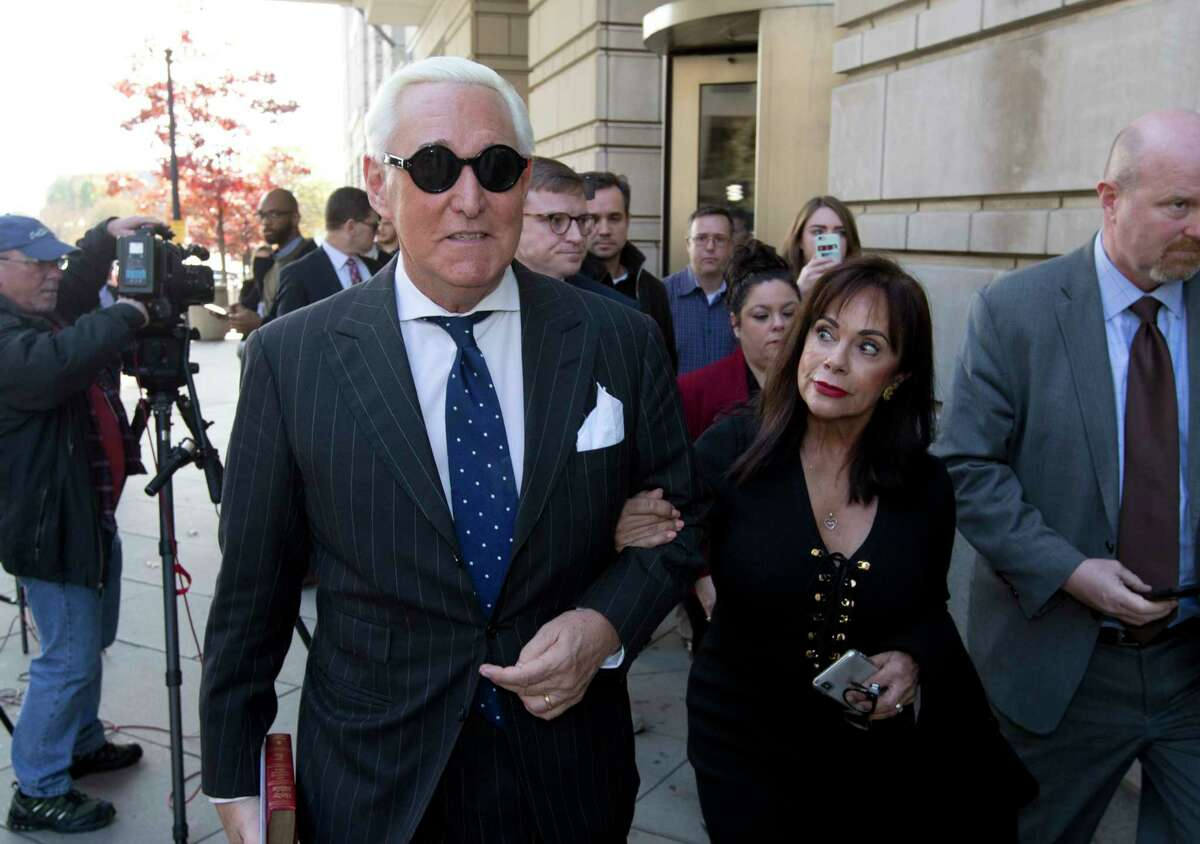 Roger Stone, left, with his wife Nydia Stone leave federal court in Washington, Friday, Nov. 15, 2019. Stone, a longtime friend of President Donald Trump, has been found guilty at his trial in federal court in Washington. (AP Photo/Jose Luis Magana)