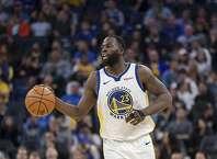 Golden State Warriors forward Draymond Green dribbles against the Utah Jazzin the first half of an NBA basketball game in San Francisco, Monday, Nov. 11, 2019. The Jazz won 122-108. (AP Photo/John Hefti)