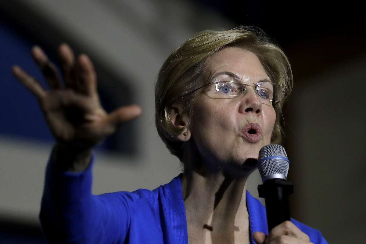 FILE - In this Nov. 11, 2019 file photo, Democratic presidential candidate Sen. Elizabeth Warren, D-Mass., addresses an audience during a campaign event in Exeter, N.H. Warren's campaign announced a drop in donations for the fourth quarter.