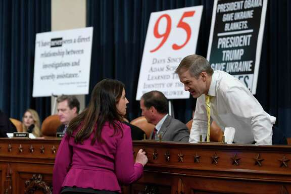 Rep. Jim Jordan, R-Ohio, right, talks with Rep. Elise Stefanik, R-N.Y., during a break in testimony with former U.S. Ambassador to Ukraine Marie Yovanovitch before the House Intelligence Committee on Capitol Hill in Washington, Friday, Nov. 15, 2019, in the second public impeachment hearing of President Donald Trump's efforts to tie U.S. aid for Ukraine to investigations of his political opponents. (AP Photo/Susan Walsh)