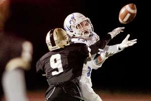 Newtown's Riley Ward reaches for a pass during the Nighthawks' 44-10 victory over Joel Barlow on Friday in Redding.